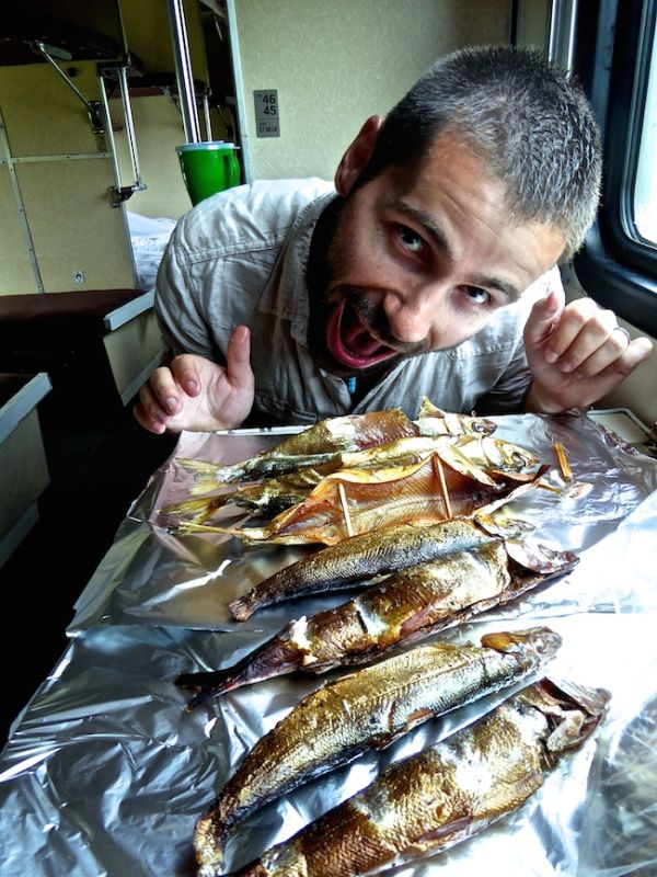 Seb about to go face down in our smoked omul fish purchased on the Trans Siberian train