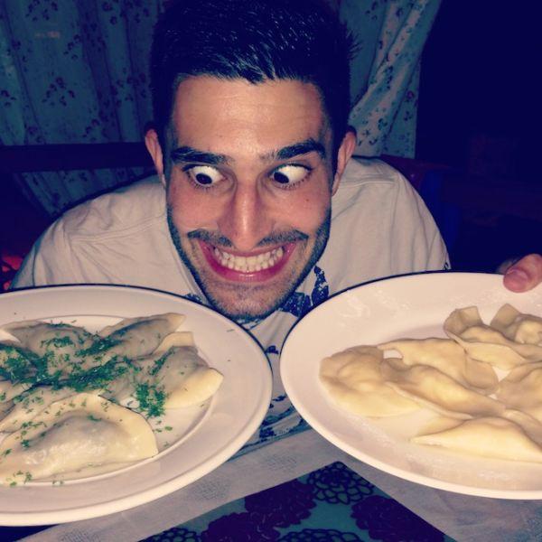 Stefan contemplating a few plates of vareniki