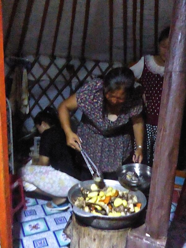 Nomadic family mother making khorkhog in our ger