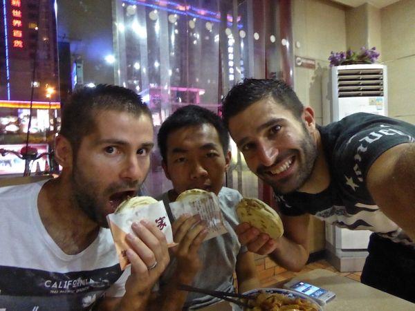 Trying Chinese hamburger rou jia mo in Xi'An's Muslim Quarter