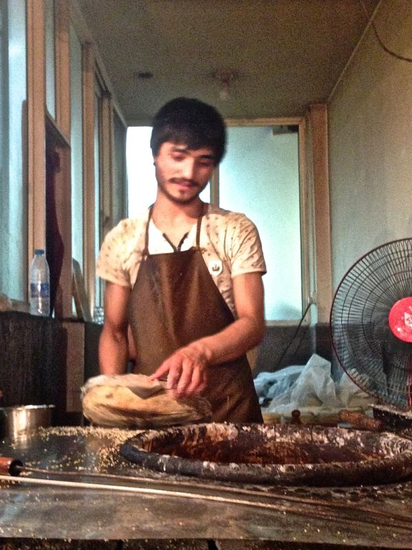 Trying freshly made flat bread in Xi'An's Muslim Quarter