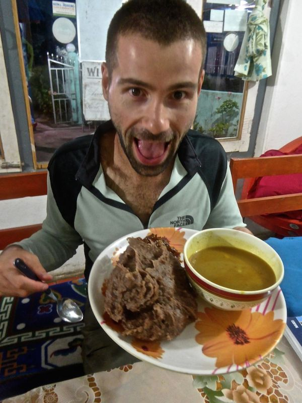 Trying dhido with vegetable curry