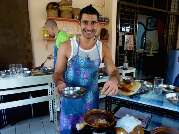 Stefan with apron cooking