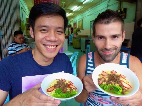 Seb and Brendan trying mee kolok in Kuching Sarawak Malaysia