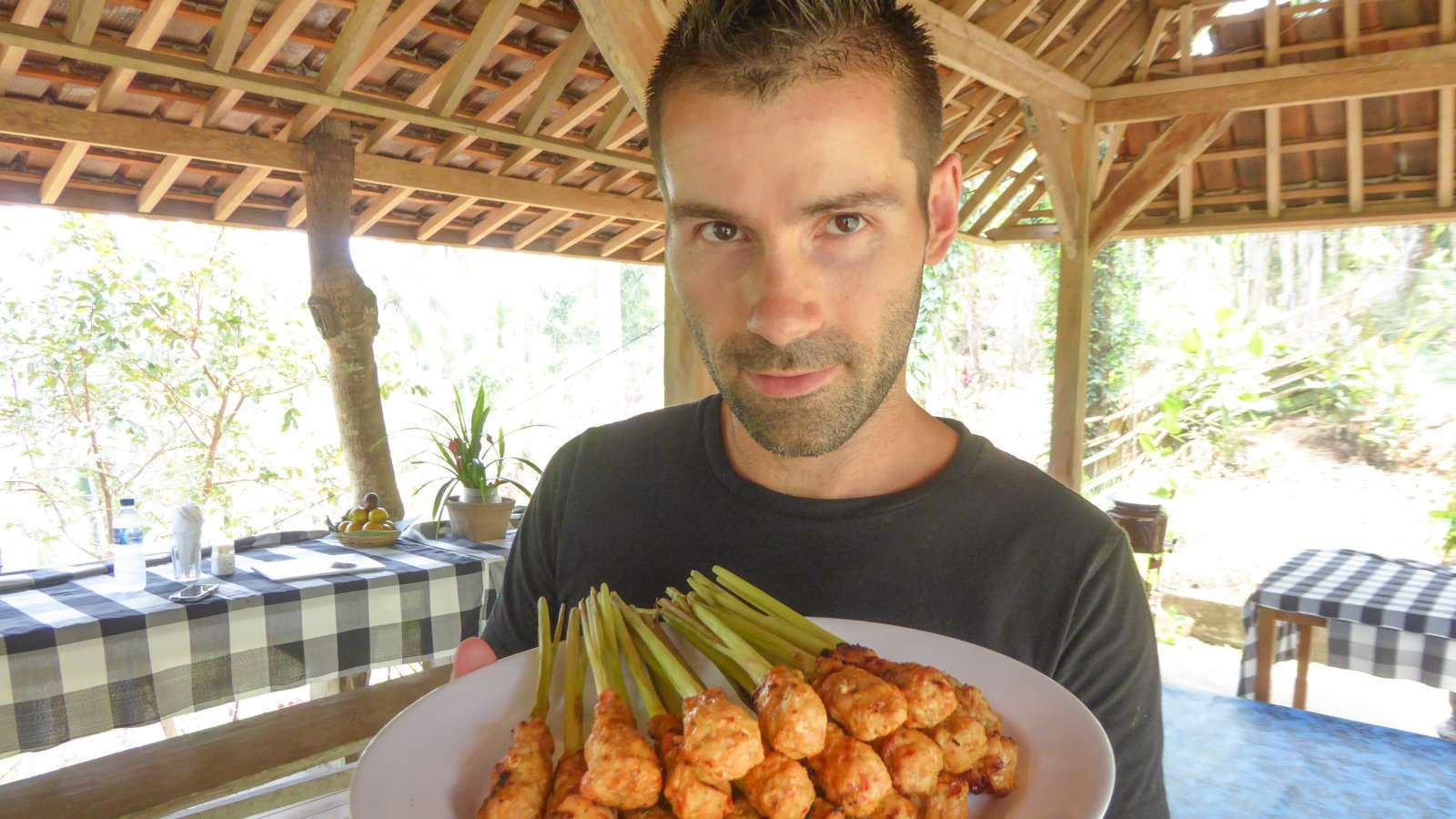 Sebastien proudly showing off his freshly made lemongrass chicken satay sticks